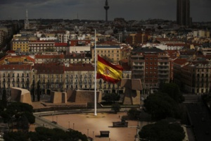A Spanish flag flies at half staff, for the victims of the Germanwings passenger jet, in Madrid, Spain. Wed, March 25, 2015. | source: ECS Group